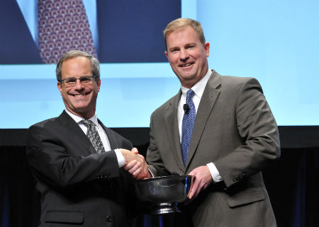 Peter Swire (left) accepts the IAPP Privacy Leadership Award from IAPP Board Chairman James Byrne.